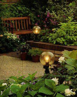 Фото - Садові ліхтарі навколо майданчика для відпочинку