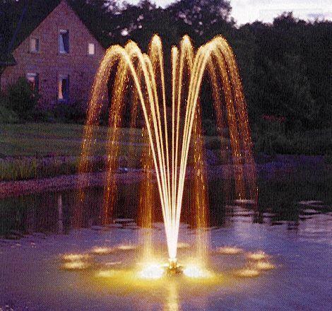 Фото - Декоративний фонтан з підсвічуванням в басейні