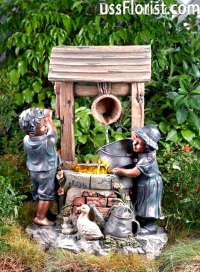 Колодязь з садовими скульптурами – фото